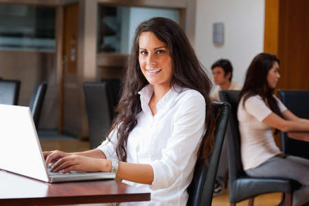 Young woman using a laptop in a cafe photo