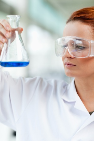 compound eyes: Portait of a science student looking at an Erlenmeyr flask in a laboratory