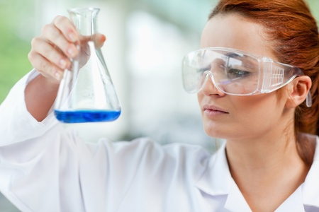 Science student looking at a liquid in a laboratory Stock Photo - 11191065