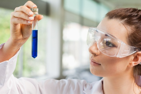 compound eyes: Female science student looking at a test tube in a laboratory Stock Photo