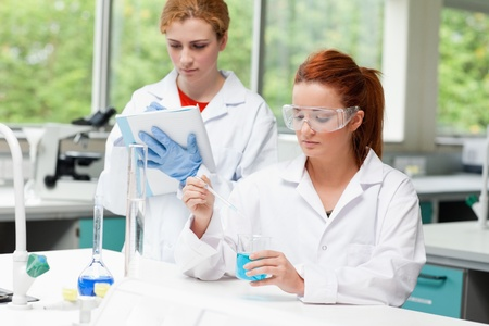 Science students doing an experiment in a laboratory photo