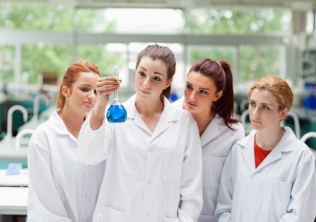 biochemist: Cute science students looking at a flask in a laboratory Stock Photo