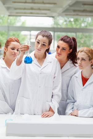 biochemist: Portrait of science students looking at a flask in a laboratory Stock Photo