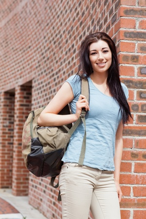 Portrait of a student standing up outside a building photo