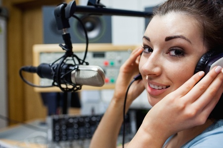 Close up of a young radio host posing in a station photo