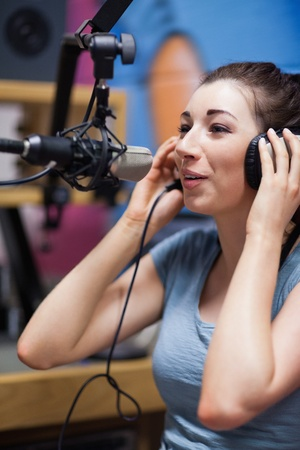 Portrait of a radio host speaking through a microphone photo