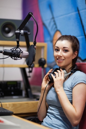 Portrait of a radio host posing during a break photo