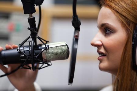 Radio host speaking through a microphone photo