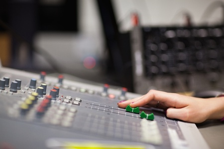 Hand setting the sound in a studio Stock Photo - 11183104