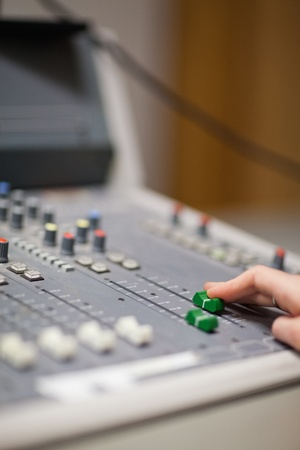 Portrait of a hand setting the sound in a studio Stock Photo - 11182959