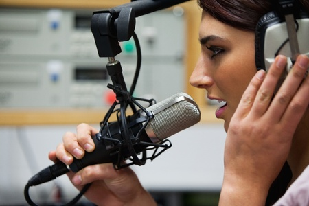 Close up of a gorgeous singer recording a track in a studio Stock Photo