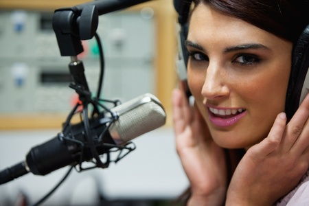radio station: Close up of a gorgeous woman posing in a studio