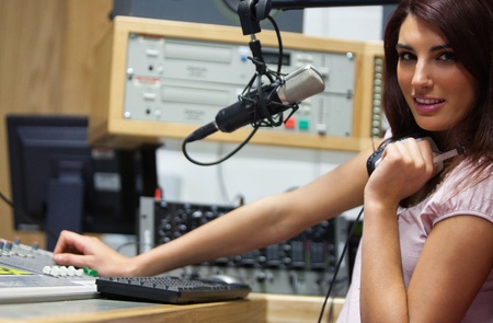 Radio host setting the sound while looking at the camera photo