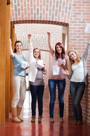Students having good marks in a corridor Stock Photo - 11182044