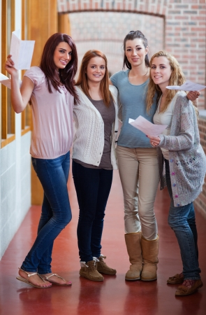 age test: Portrait of students having their results in a corridor Stock Photo