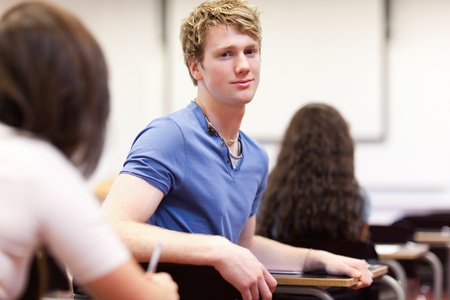 Student sitting at a table in a classroom Stock Photo - 11183617