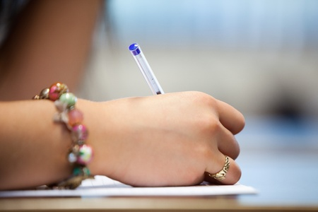 essay: Close of a hand writing on a paper Stock Photo
