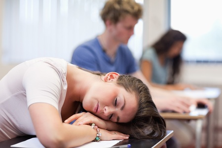 Tired student sleeping in a classroom Stock Photo - 11183804