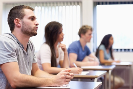 Handsome young man listening in a classroom Stock Photo - 11183672