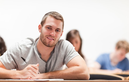 Smiling student sitting in an amphitheater Stock Photo - 11184192