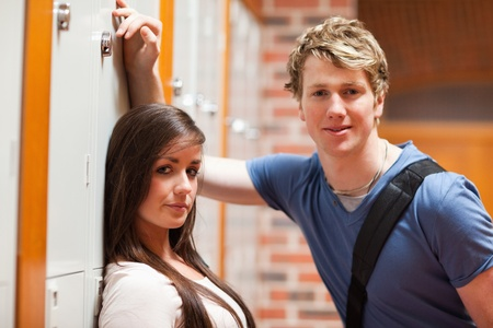 Good looking couple flirting in a corridor photo
