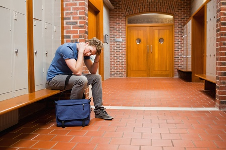 Tired student sitting on a bench Stock Photo - 11183597