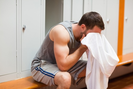 Sports student drying his head with a towel photo