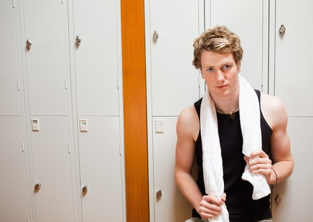 Handsome young sports student posing with a towel photo
