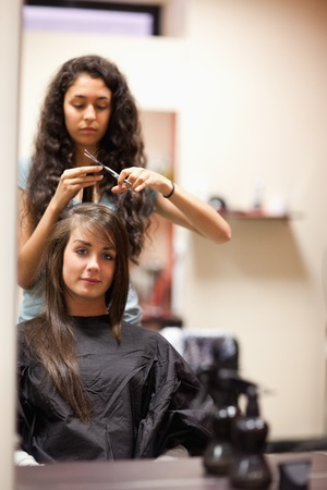 Portrait of a woman having a haircut while looking at the camera photo