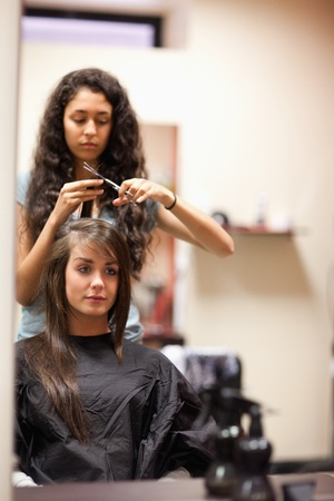 Portrait of a young woman having a haircut looking away from the camera photo