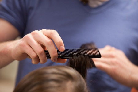 Hand combing hair with a comb photo