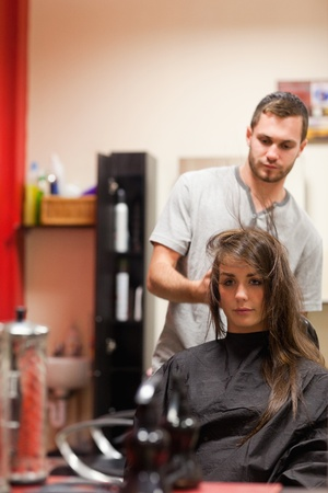 tavern: Portrait of a hairdresser blowing hair of a customer Stock Photo
