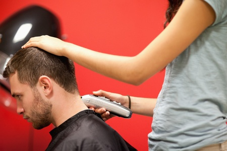 shorten: Male student having a haircut with a hair clippers Stock Photo