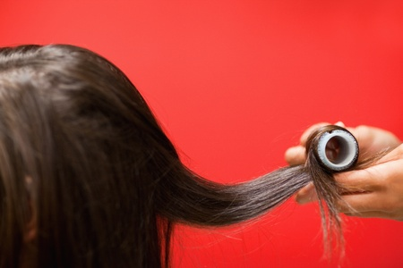 Close up of hands rolling hair with a curler Stock Photo - 11182345