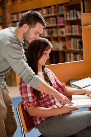 Portrait of students working in a library photo
