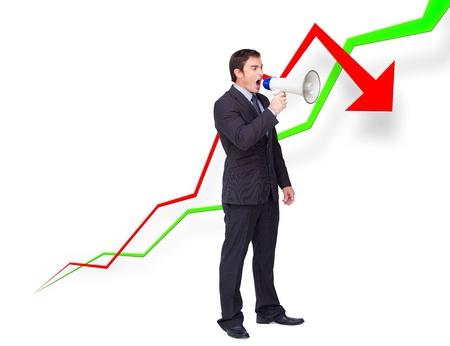 businessman using a megaphone: Young businessman using a megaphone against curves