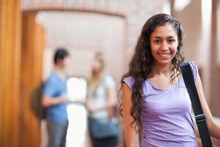 Young student posing in a corridor photo