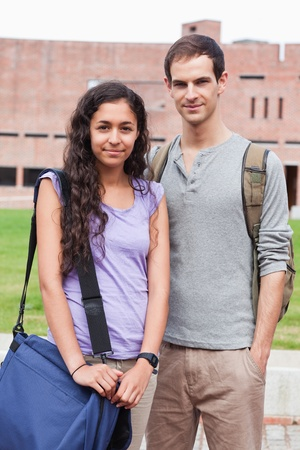Portrait of a student couple posing outside a building Stock Photo - 11182009