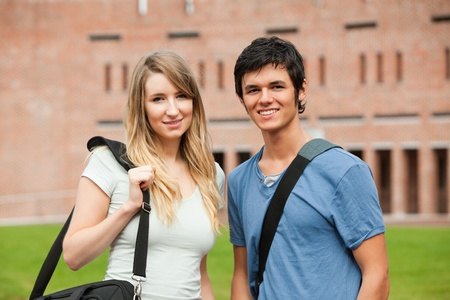Young student couple posing outside a building Stock Photo - 11183118