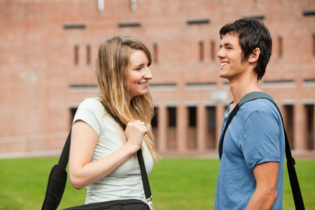 Young student couple flirting outside a building Stock Photo - 11183291
