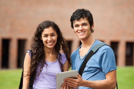 Couple holding a tablet computer outside a building Stock Photo - 11183304