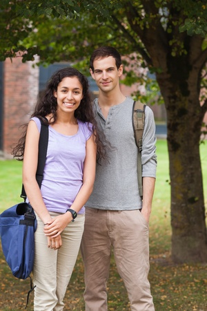 Portrait of a couple posing in front of a tree Stock Photo - 11183531