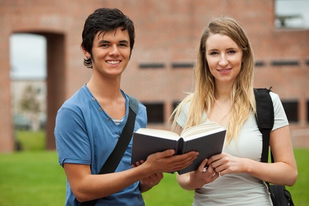 Cute couple holding a book outside a building Stock Photo - 11182075