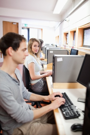 Portrait of a fellow students using a computer in an IT room photo