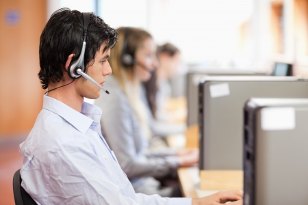 Young operators using a computer in a call center photo
