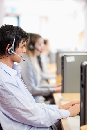 Portrait of young operators using a computer in a call center Stock Photo - 11184199