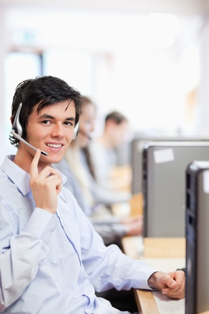 Portrait of an operator posing with a headset in a call center photo