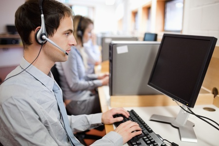 Serious operator using a computer in a call center Stock Photo - 11183359