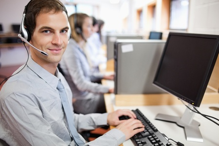 Assistant using a computer in a call center Stock Photo - 11183663
