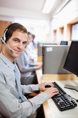 Portrait of an assistant using a computer in a call center photo